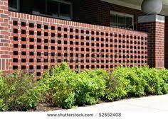 Decorative Brick Fence | decorative brick wall, ornamental and plesant. -  stock photo
