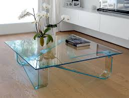 unico contemporary glass wind coffee table with curved legs thumbnail