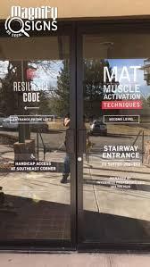 custom window vinyl on the front glass doors of resilience code in denver co