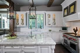 exquisite traditional kitchen iron chandelier features white tile backsplash paired double oven paired integrated range hood with glass cabinets