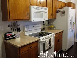 simple particle board kitchen cabinets with distressed wood and painting