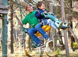 stock photo boys swinging on an outdoor play structure gimli manitoba canada