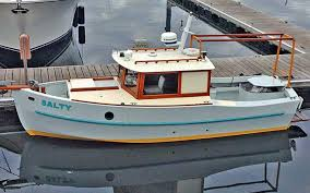 surveys of pleasure and fishing vessels jim and his wife former sail maker nora petrich now cruise puget sound in their 22 devlin surf scoter salty