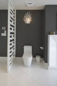duravit toilet bathroom contemporary with branches ceiling fan charcoal walls fireplace fretwork tile baseboard baseboards ceiling fan
