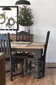 rustic farmhouse dining room table and chairs painted black and paired with wood floors