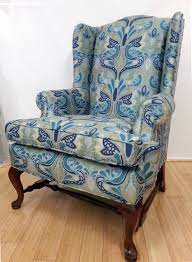 Reupholstered wing chair in floral bird print fabric from Duralee Fabrics.  Upholster by Blawnox Upholstery