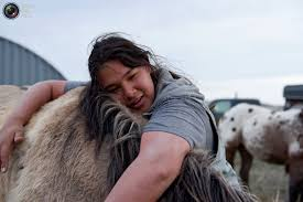 Image result for Tatanka Itancan Lone Eagle, 15, from Bridger on the Cheyenne River Reservation, hugs his horse at the end of the day during the Fort Laramie treaty ride in Scenic, South Dakota. 19 Apr 2018. Scenic, United States. Reuters/Stephanie Keith Lucille Contreras, one of the Fort Laramie treaty riders, from the Pine Ridge Reservation poses for a photo in the tribal area on the grounds of the Fort Laramie National Historic Site in Fort Laramie, Wyoming. 29 Apr 2018. Fort Laramie, United States. Reuters/Stephanie Keith The Fort Laramie Treaty riders take a break after arriving at the Fort Laramie National Historic Site in Fort Laramie, Wyoming. 27 Apr 2018. Fort Laramie, United States. Reuters/Stephanie Keith Jayden Lookinghorse stands on top of a hill at Arvol Lookinghorse's home on the Cheyenne River Reservation in Green Grass, South Dakota. 30 May 2018. Green Grass, United States. Reuters/Stephanie Keith Horses run through a river near Arvol Lookinghorse's home on the Cheyenne River Reservation in Green Grass, South Dakota. 30 May 2018. Green Grass, United States. Reuters/Stephanie Keith Roderick Dupris (centre on white horse), 45, from Bridger on the Cheyenne River Reservation, rides with other Fort Laramie treaty riders along Van Tassel Road in Torrington. 26 Apr 2018. Torrington, United States. Reuters/Stephanie Keith A horse is decorated with a hand print. 27 Apr 2018. Fort Laramie, United States. Reuters/Stephanie Keith Fronda White, 10, from the Standing Rock Reservation, one of the Fort Laramie treaty riders, laughs after failing to get up onto her horse in the tribal area on the grounds of the Fort Laramie National Historic Site in Fort Laramie, Wyoming. 29 Apr 2018. Fort Laramie, United States. Reuters/Stephanie Keith A small herd of buffalo graze near the Sage Creek campground in the Badlands National Park outside of Wall, South Dakota. 19 Apr 2018. Wall, United States. Reuters/Stephanie Keith Cody James Lookinghorse (left) and Maryann Lara play 