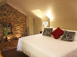 Decorations:Natural Stone Accents Wall For Attic Bedroom Complete With  White Bedding Also Built In