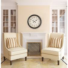 oversized wall clock with double chair and fireplace for home interior design ideas