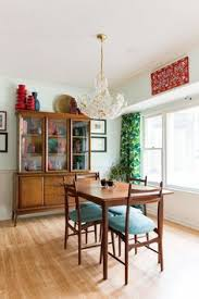 house tour a colorful 90s ranch style south carolina home mid century modern tablemid century modern furnituremid century moderndining