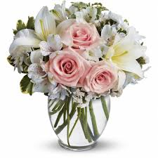 a cute vase of white flowers with touches of pink arrive in style bouquet