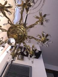 i d my 8 arm solid brass chandelier beautiful large 8 arms chandelier for in excellent working condition with 80 crystals clean and beautiful