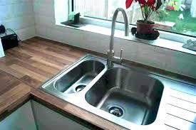 kitchen drain smells kitchen sink smell bad smell from sink kitchen rh touristwonder info chemical smell under kitchen sink horrible smell under kitchen