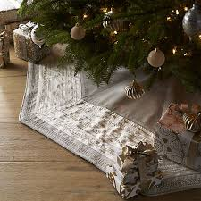 trimmed with faux pearls and metallic stitching an ethereal ivory border that adds luxurious contrast to this handcrafted flaxhued tree skirt crate barrel christmas skirt t32