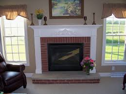 painted white mantle holly show how beautiful the contrast looks brick fireplacesfireplace