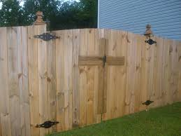 wood fence double gate. Cross Design By Advent Fence Company Wood Double Gate