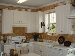 decorating above kitchen cabinets brown counter recessed lights dark granite countertop white gloss wooden island