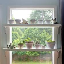 Easy tutorial to make these shelves to grow plants in a sunny window. Keep  them