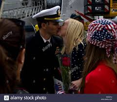 180119-N-NI420-0190 SAN DIEGO (Jan.19, 2018) Lt. Dustin Crawford, combat  systems officer aboard the littoral combat ship the future USS Omaha (LCS  12), kisses his wife Angie Crawford on the pier as the