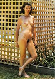 Sexy vintage mom gets naked and poses outdoor