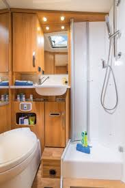 the roomy comfort bathroom has a separate shower cubicle with fixed walls and a large standing