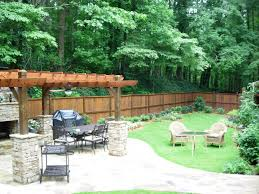 this backyard design includes a new cedar fence around the entire yard a large crab orchard stone patio with pergola over near outdoor landscaping d6 landscaping