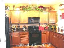 above kitchen cabinet storage ideas decorating top of