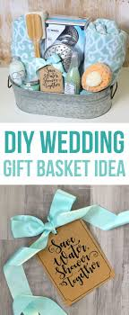 This DIY wedding gift basket idea has a shower theme and includes bath  towels, a