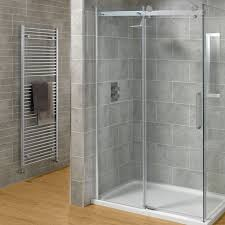 favorable frameless glass shower doors ideas with grey ceramic wall on brown laminate wooden floor complete with wall mount metal towel hanger
