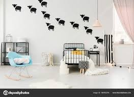 cozy blue black bedroom. Blue Rocking Chair And Stool In Cozy Bedroom Interior With Pastel Lamp  Above Bed Black Sheep Stickers On The Wall \u2014 Photo By Photographee.eu Blue E