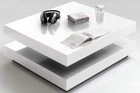 the hugo coffee table comes in stunning white high gloss keeping things interesting the top swivels separately from the base and creates a new shape to