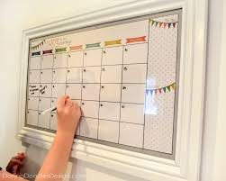 This is a pretty big calendar, lots of room to organize! Once cut and in  the frame we hung it up on a large empty wall in our kitchen.