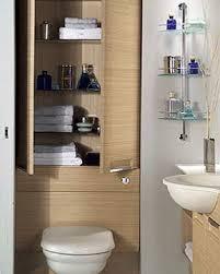 bathroom storage behind toilet and glass design ideas