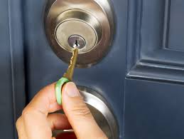 residential locksmith. Female Hand Putting House Key Into Door Lock Residential Locksmith K