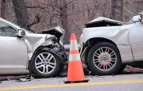 officials investigate a fatal head on collision on route 1 at the town line of wiscet and woolwich in maine in may
