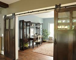 view in gallery barn style doors conceal a spacious and traditional home office design