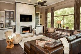 austin red leather sectional with traditional artificial hydrangeas family room transitional and brown sofa beige area