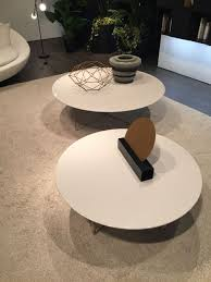white circle coffee table with a wire base
