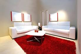 red rugs for living room minimalist living room with grey walls 2 white sofas and large red rugs
