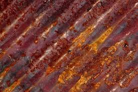 rust pattern at angle on corrugated metal sheet stock photo