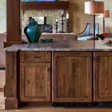 rustic cabinets. Rustic Wood Cabinets With Green Ceramic Pot
