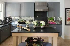 on the opposite end of the color spectrum black countertops are another great option for pairing with your gray kitchen cabinets as with white there are