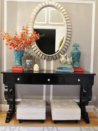 entryway table with mirror. Chic Entryway Decor Idea For Small Apartment With Black Side Table And Oval Sunburst Mirror