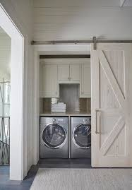 hallway laundry room with pecky cypress barn door on rails