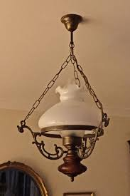 retro style oil lamp ceiling light with antiqued brass wood opaque glass