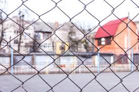 chainlink fence rust rusty steel chain link or wire mesh as boundary wall there is chainlink fence rust