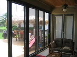 the benefits of porch enclosures porch enclosures and sliding glass doors create a special ambiance to