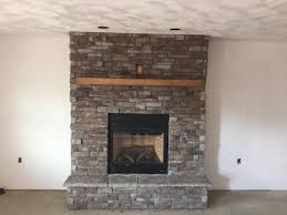 how much does it cost to put stone on a fireplace faux panels stacked fireplaces