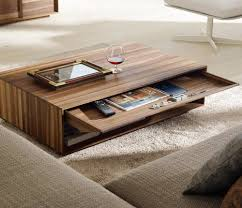 Modern Rectangular Wooden Unique Coffee Table Ideas Along With Wine Glass  Frame Picture Some Books On Drawer And U Shape Sofa