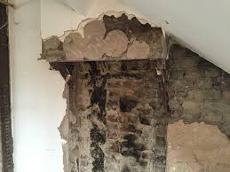 removing a chimney t without providing sufficient support to the remaining masonry above will cause movement and inility to the stack